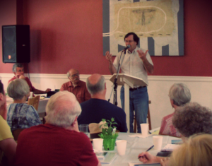 """Jack Crabtree presenting his paper, """"How To Follow Jesus When You Cannot Kill the Beast,"""" at Gutenberg College's 2013 Summer Institute."""